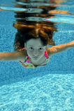 Child jumps to swimming pool Stock Photo
