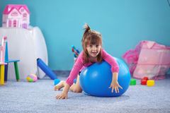 Child on jymnastic ball Stock Photos