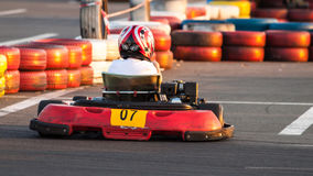 Child at kart racing, back view. Royalty Free Stock Photos