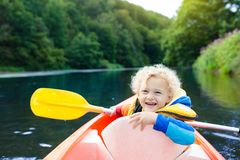 Child on kayak. Kids on canoe. Summer camping. Royalty Free Stock Photo