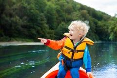 Child on kayak. Kids on canoe. Summer camping. Royalty Free Stock Image