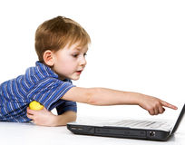 Child is keen on a computer game Stock Photography