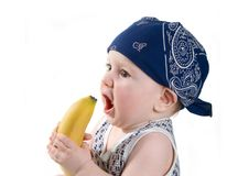 Child keeps banana Stock Photos