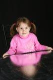 Child keeps in hand reflector. Child on dark background, keeps in hand reflector Stock Images