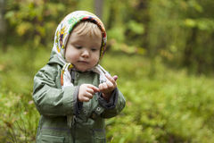 Child in a kerchief at the forest Stock Images