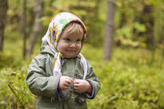 Child in a kerchief at the forest Royalty Free Stock Photography