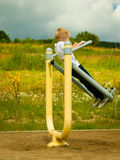Child kid in action boy play on stretching equipment Stock Image