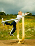 Child kid in action boy play on stretching equipment Stock Photography