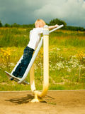 Child kid in action boy play on stretching equipment Royalty Free Stock Photos