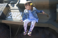 Child, kid, baby, infant, youngster, girl on Armored personnel carrier Royalty Free Stock Photography