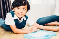Child kid boy kindergarten education drawing. At interior room home royalty free stock image