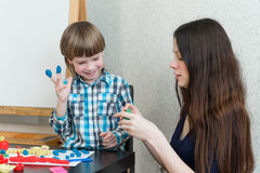 Child kid boy and mother play colorful clay stock image