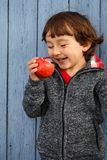 Child kid eating apple fruit smiling outdoor autumn fall healthy Stock Photo