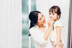 Child kid girl kindergarten and beautiful mother. At interior room home royalty free stock photo