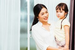 Child kid girl kindergarten and  beautiful mother Stock Photography