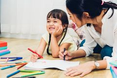Child kid girl kindergarten drawing teacher education mother wit Royalty Free Stock Photo