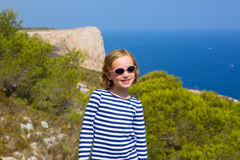 Child kid girl in mediterranean sea with sailor stripes Stock Photos