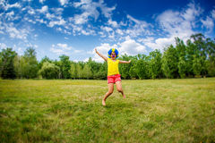 Child kid girl with party clown blue wig funny happy open arms expression and garlands is jumping Royalty Free Stock Photos