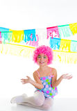 Child kid girl with party clown pink wig funny expression. And garlands Royalty Free Stock Photography