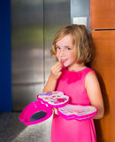 Child kid girl playing with makeup lipstick in the lift door Royalty Free Stock Images