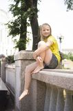 Child kid girl taking rest near fountain Royalty Free Stock Images