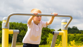 Child kid having fun in playground air walker. Stock Images