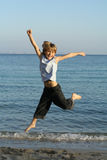 Child or kid jumping. Happy smiling boy child or kid jumping for joy on  beach summer vacation Stock Photography