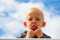 Child kid making silly face. Childhood. Royalty Free Stock Photo