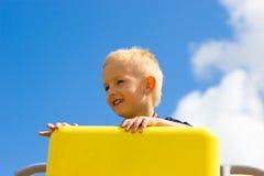 Child kid in playground climbing playing. Stock Photos