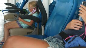Child kid in protective mask use smartphone