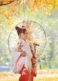 Child in kimono with umbrella Royalty Free Stock Photography