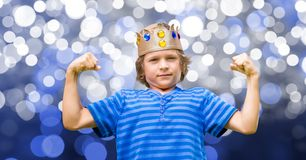 Child with king crown and blue tee shirt and blue background Royalty Free Stock Image