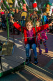 Child on kirtag in kettenkarusell, carousel, ka Royalty Free Stock Image