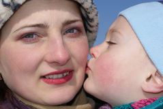 The child kisses his mother Royalty Free Stock Photos