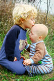 Child Kissing Baby Brother Stock Photography