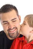 Child kissing dad on the cheek Stock Photo