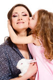 Child kissing mother. A cute happy child kissing mother Stock Image