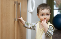 Child in kitchen Stock Images