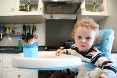 Child on the kitchen stock image