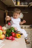 Child at the kitchen Royalty Free Stock Photo