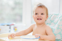 The child in the kitchen ate porridge Royalty Free Stock Image