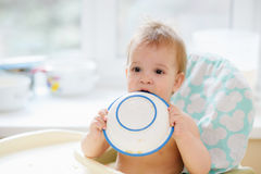 The child in the kitchen ate porridge Royalty Free Stock Images
