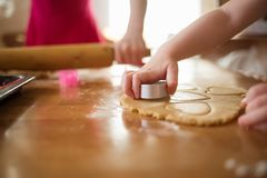 Child in the kitchen makes homemade cookies. royalty free stock photo