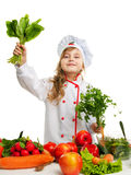 Child in the kitchen preparing a meal Royalty Free Stock Image
