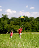 Child with kite. Children flying a kite on a sunny summer day, having lots of fun Royalty Free Stock Images