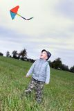 Child with kite fly Stock Photography