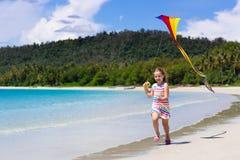 Child with kite. Kids play. Family beach vacation royalty free stock photos