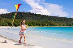 Child with kite. Kids play. Family beach vacation stock image