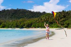 Child with kite. Kids play. Family beach vacation stock photos