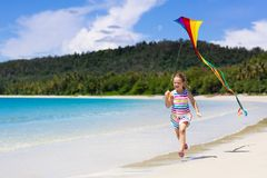 Child with kite. Kids play. Family beach vacation stock images